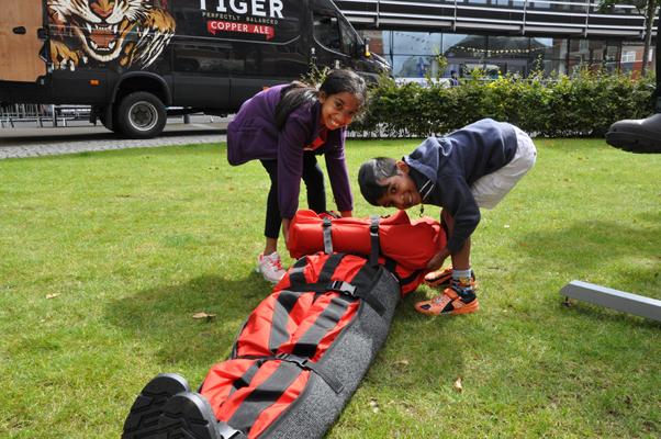 children test the casualty evacuation manikin