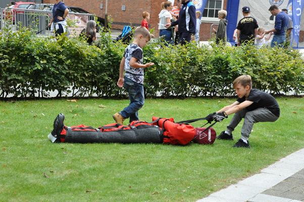 firefighter challenge - child pulls casualty evacuation manikin