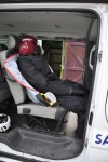 Manikin and suit placed within vehicle ready to be filled with water