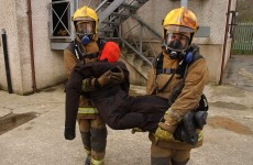 Firemen carrying Ruth Lee Manikin out of fire house in North Wales